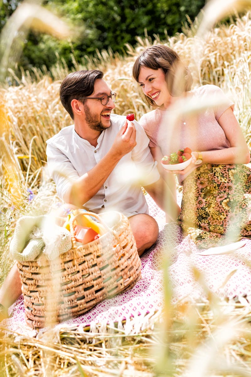 couple laying in grass picknicking